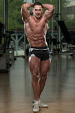 Young Bodybuilder Flexing Muscles Royalty Free Stock Photo