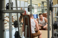 Young bodybuilder in gym. Royalty Free Stock Photography