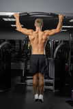 Young bodybuilder in the gym Stock Photo