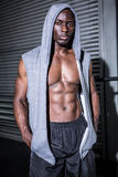Young Bodybuilder in a hoodie looking at the camera Royalty Free Stock Photography