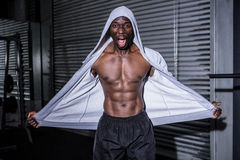 Young Bodybuilder in a hoodie looking at the camera totally surprised Stock Photography