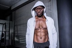 Young Bodybuilder in a hoodie looking at the ground Royalty Free Stock Images