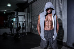 Young Bodybuilder in a hoodie looking at the ground Royalty Free Stock Photography