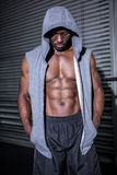 Young Bodybuilder in a hoodie looking at the ground Stock Images