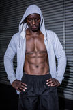 Young Bodybuilder in a hoodie looking worriedly to the ground Royalty Free Stock Images