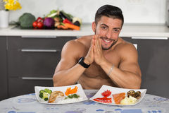 Young bodybuilder in the kitchen Stock Image