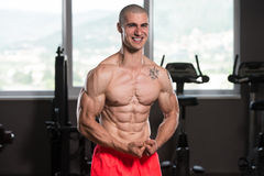 Young Bodybuilder Making Most Muscular Pose Royalty Free Stock Photos