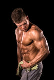 Young bodybuilder man holding towel Stock Photo