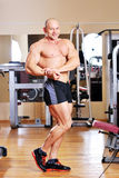 Young bodybuilder posing at gym Royalty Free Stock Images