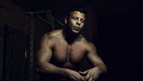 Young bodybuilder posing in a gym Royalty Free Stock Images