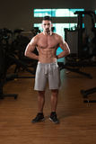 Young Bodybuilder Posing In The Gym Royalty Free Stock Photos