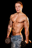 Young bodybuilder posing in jeans Royalty Free Stock Photography