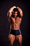 Young bodybuilder posing. In studio Royalty Free Stock Photography