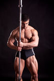 Young bodybuilder posing. In studio Royalty Free Stock Image