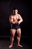 Young bodybuilder posing. In studio Stock Image