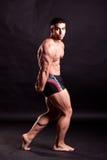 Young bodybuilder posing. In studio Stock Images