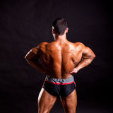 Young bodybuilder posing Royalty Free Stock Photo