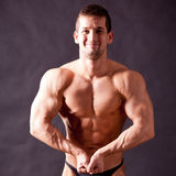 Young bodybuilder posing Stock Photos