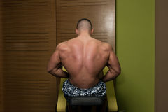 Young Bodybuilder Showing His Well Trained Back Royalty Free Stock Photo