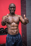 Young Bodybuilder standing in front of the camera with his thumbs up Royalty Free Stock Photography