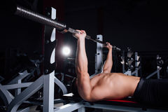 Young bodybuilder training in the gym,chest - barbell incline bench press stock images