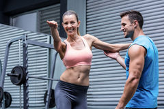 Young Bodybuilder training a young woman stock image
