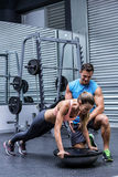 Young bodybuilder training with a young woman Royalty Free Stock Photo