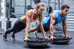 Young bodybuilder training with a young woman royalty free stock images