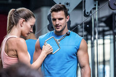 Young Bodybuilder training a young woman royalty free stock photos