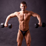 Young bodybuilder traininig Stock Photos