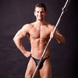 Young bodybuilder traininig. Over balck background Royalty Free Stock Photos