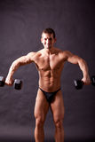 Young bodybuilder traininig Stock Images