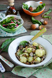 Young boiled potatoes with mushrooms Stock Images