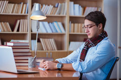The young book writer writing in library Stock Images