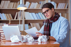 The young book writer writing in library Royalty Free Stock Photos