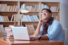 The young book writer writing in library Stock Photos