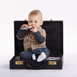Young bookkeeper with suitcase of money Royalty Free Stock Photography