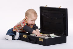 Young bookkeeper with suitcase of money Royalty Free Stock Images