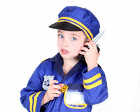 Young booy in police costume. Young boy in police costume with hand radio Royalty Free Stock Image