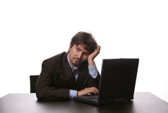 Young bored business man. Working with is laptop stock photos