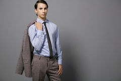 Young boss. Attractive young businessman in gray suit Stock Photography