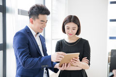 Young boss and assistant at work Stock Images