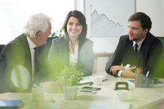 Young boss with employees. During business meeting Stock Photos