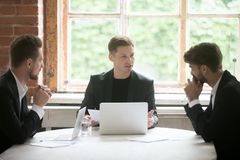 Young boss instructing employees during briefing meeting. Stock Photography