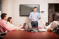 Young boss leading a meeting Stock Images