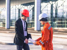 Young boss and worker in conversation discussing construction pr Stock Images