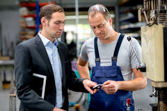 Young boss and worker in conversation Royalty Free Stock Image