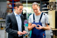 Young boss and worker in conversation Stock Images