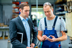 Young boss and worker in conversation Stock Photos