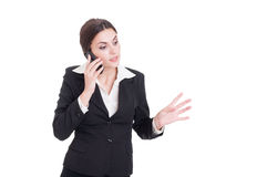 Young bossy business manager woman talking on the phone Royalty Free Stock Photos